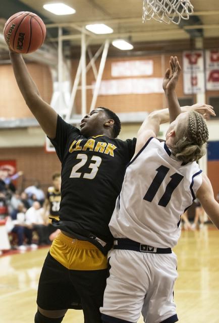 Clark's  Antwon Jackson (23) grabs a rebound over Foothill's John Platt (11) on Tuesday, Feb. 21, 2017, at Valley High School, in Las Vegas. (Benjamin Hager/Las Vegas Review-Journal) @benjaminhphoto