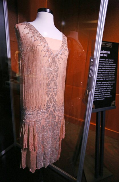 "A peach chiffon evening dress is displayed in ""Ready to Roar: evening fashions of the prohibition women"" at The Mob Museum Thursday, Nov. 3, 2016, in Las Vegas. (Ronda Churchill/Las Vegas Review-J ..."