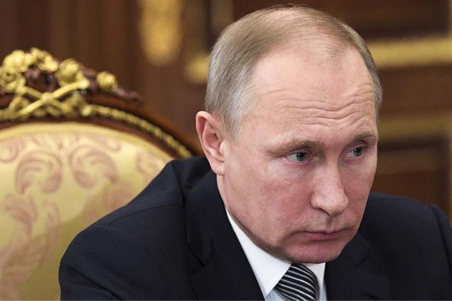 Russian President Vladimir Putin listens to during a meeting in the Kremlin in Moscow, Russia, Friday, Feb. 3, 2017. (Alexei Druzhinin/Sputnik, Kremlin Pool Photo via AP)
