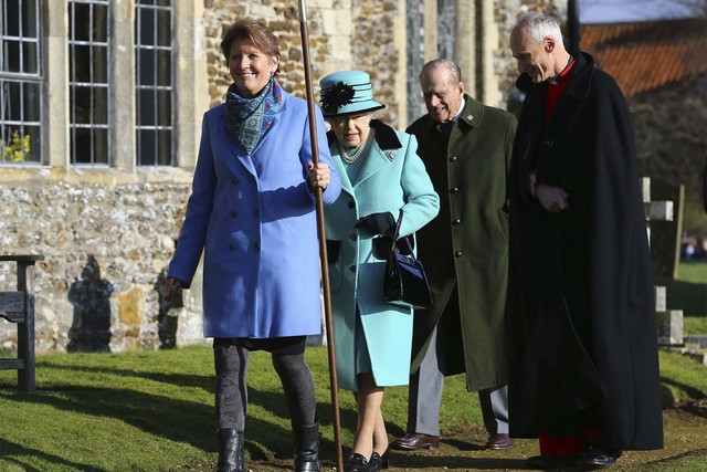 Britain's Queen Elizabeth II and her husband Duke of Edinburgh, arrive at St Peter and St Paul at West Newton, England, Sunday.  The queen is to make history on Monday Feb. 6,  when she becomes th ...