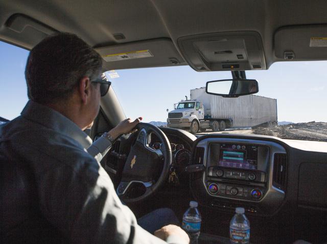 Scott Seastrand, VP at Western Elite, passes garbage hauler at the Western Elite Ranch near U.S. 93 Highway about 60 miles north of Las Vegas on Wednesday, Jan. 25, 2017. (Jeff Scheid/Las Vegas Re ...