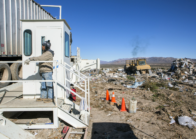 A worker watches a garbage hauler back in to dump at the Western Elite Ranch near U.S. 93 Highway about 60 miles north of Las Vegas on Wednesday, Jan. 25, 2017. (Jeff Scheid/Las Vegas Review-Journ ...
