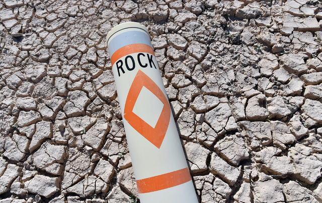 A warning buoy lies in the dry earth at the Echo Bay Marina Tuesday, April 26, 2016, at Lake Mead National Recreation Area. The shrinking reservoir could soon get a boost from what is shaping up t ...