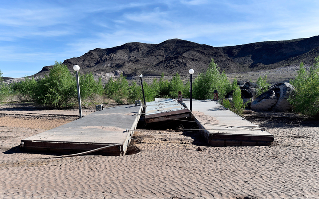 Boat docks rest on dry land at Echo Bay Marina Tuesday, April 26, 2016, at Lake Mead National Recreation Area. A wet winter on the Colorado River is expected to keep the lake above the federal sho ...
