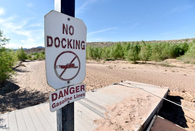 Brush encroaches on beached boat docks at the Echo Bay Marina Tuesday, April 26, 2016, at Lake Mead National Recreation Area. Forecasters expect the lake to see a boost from a wetter than average  ...