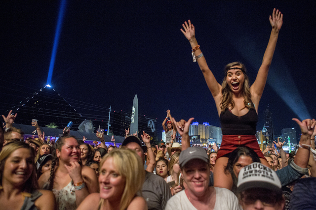 The crowd cheers as Chris Young performs during the second night of Route 91 Harvest country music festival at the MGM Resorts Village festival site in Las Vegas on Saturday, Oct. 1, 2016. Elizabe ...
