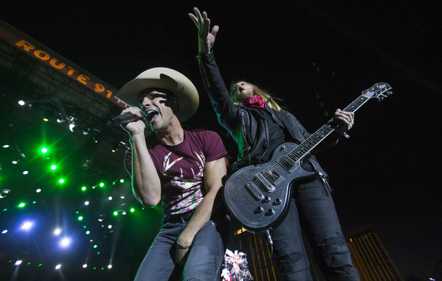 Country music artist Dustin Lynch, left, and his guitarist perform for fans on Day 3 of the Route 91 Harvest country music festival at the Las Vegas Village on Oct. 2, 2016. (Richard Brian/Las Veg ...