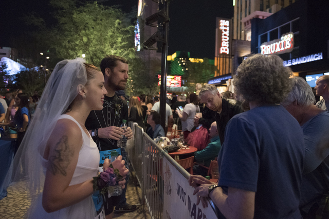 Kelsey Vallentine, left, and Monty Montague, second from left, of New Mexico greet family members as they prepare to get married during the Rock 'n' Roll Marathon's Run-Thru Weddings at The Park o ...