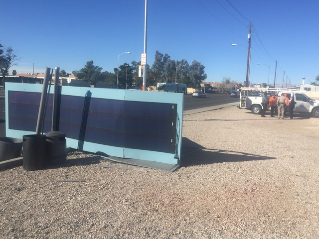 A fallen bus stop structure has injured one person after a car crash on February 24, 2017. (Wesley Juhl/Las Vegas Review-Journal)