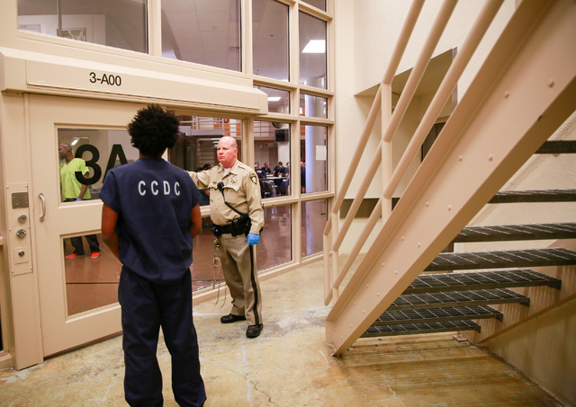 An inmate is moved at Clark County Detention Center in 2016. The Trump administration has threatened to withhold federal funding to police departments that don't fully cooperate with immigration a ...