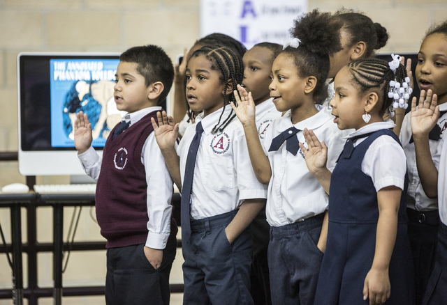 Students at Andre Agassi Preparatory Academy recite the school oath during a press conference to announce that Democracy Prep Public Schools will assume school operations of Andre Agassi Preparato ...