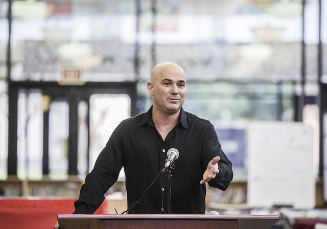 Andre Agassi answers questions during a press conference to announce that Democracy Prep Public Schools will assume school operations of Andre Agassi Preparatory Academy in the fall of 2017. Photo ...
