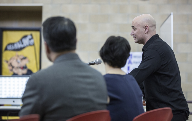 Andre Agassi, right, answers questions during a press conference to announce that Democracy Prep Public Schools will assume school operations of Andre Agassi Preparatory Academy in the fall of 201 ...