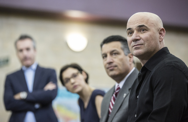 Andre Agassi, right, Nevada Gov. Brain Sandoval and Katie Duffy, CEO of Democracy Prep Public Schools, listen to a question from the media during a press conference to announce that Democracy Prep ...