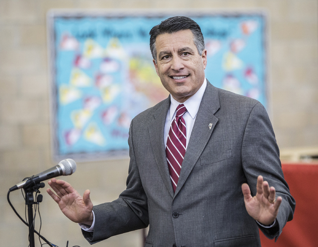 Nevada Gov. Brain Sandoval answers questions from the media during a press conference to announce that Democracy Prep Public Schools will assume school operations of Andre Agassi Preparatory Acade ...