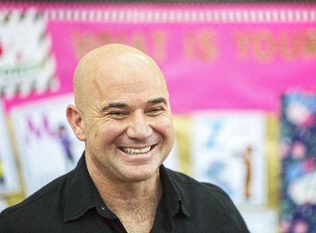 Andre Agassi shares a laugh with media members during a press conference to announce that Democracy Prep Public Schools will assume school operations of Andre Agassi Preparatory Academy in the fal ...