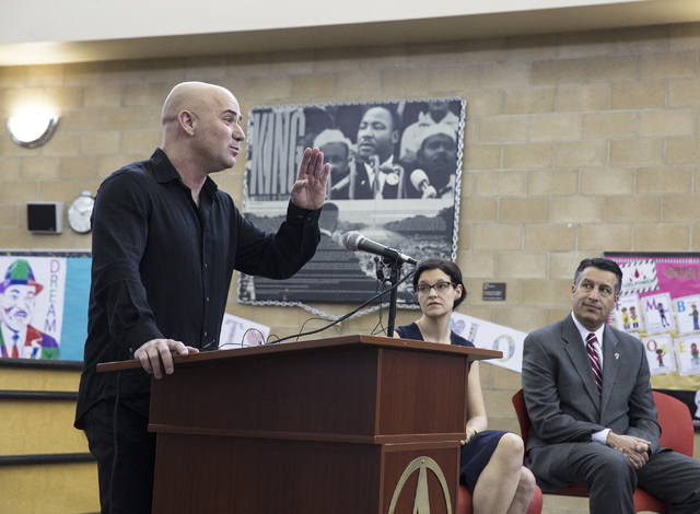 Andre Agassi, left, answers questions during a press conference to announce that Democracy Prep Public Schools will assume school operations of Andre Agassi Preparatory Academy in the fall of 2017 ...