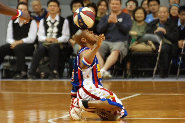 Scooter Christensen of the Harlem Globetrotters shows his basketball skills during their show, Wednesday, Dec. 2, 2009, in Taipei, Taiwan.(Chiang Ying-ying/AP)
