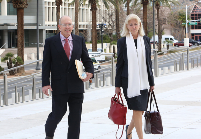 Gregory Olson, a former church treasurer charged with stealing as much as $1.4 million from the congregation, walks with his attorney Kathleen Bliss to Lloyd George U.S. Courthouse on Tuesday, Feb ...