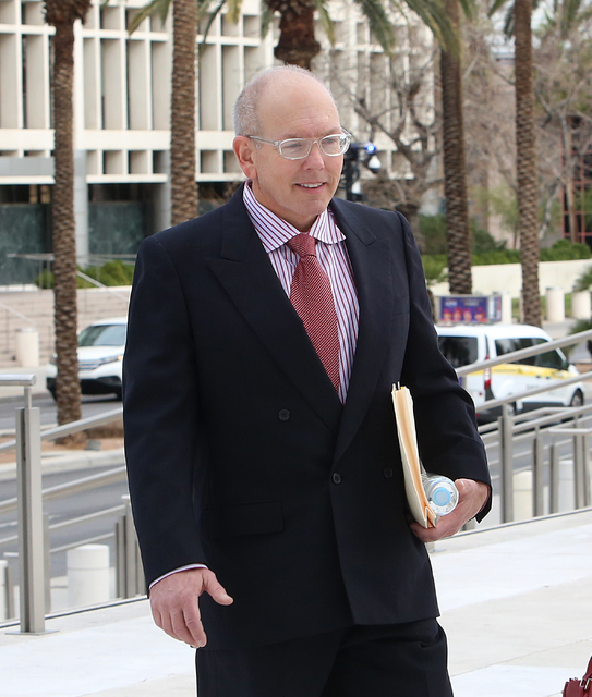 Gregory Olson, a former church treasurer charged with swindling as much as $1.4 million from the congregation, walks to Lloyd George U.S. Courthouse on Tuesday, Feb. 21, 2017, in Las Vegas. (Bizua ...