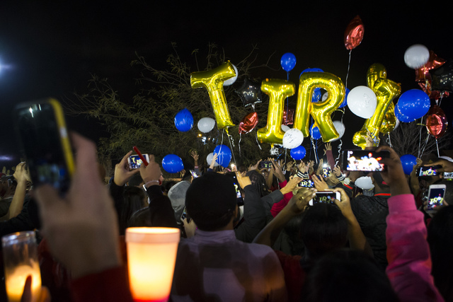 Balloons spelling out the first name of Shadow Ridge High School student Tiris Coleman Jr, who was killed in a shooting this past Sunday, are released during a vigil at Aviary Park in North Las Ve ...