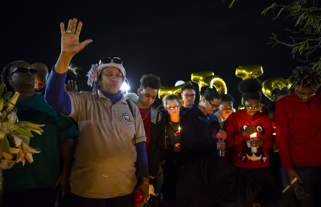 Wanda Dunmore leads a prayer during a vigil for Shadow Ridge High School student Tiris Coleman Jr, who was killed in a shooting this past Sunday, at Aviary Park in North Las Vegas on Tuesday, Feb. ...