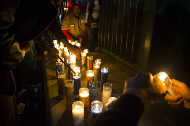 Candles are lit during a vigil for Shadow Ridge High School student Tiris Coleman Jr, who was killed in a shooting this past Sunday, at Aviary Park in North Las Vegas on Tuesday, Feb. 21, 2017. (C ...
