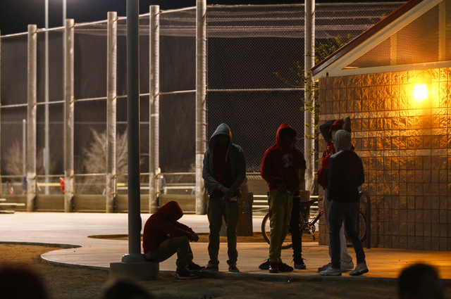 People arrive for a vigil for Shadow Ridge High School student Tiris Coleman Jr, who was killed in a shooting this past Sunday, at Aviary Park in North Las Vegas on Tuesday, Feb. 21, 2017. (Chase  ...