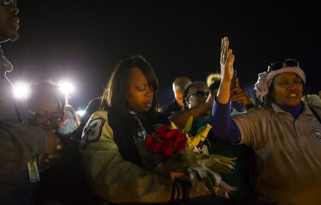 Quiana Burns, mother of Shadow Ridge High School student Tiris Coleman Jr, who was killed in a shooting this past Sunday, stands during a vigil at Aviary Park in North Las Vegas on Tuesday, Feb. 2 ...