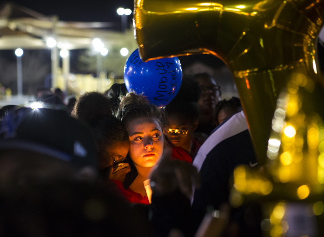 People gather during a vigil for Shadow Ridge High School student Tiris Coleman Jr, who was killed in a shooting this past Sunday, at Aviary Park in North Las Vegas on Tuesday, Feb. 21, 2017. (Cha ...