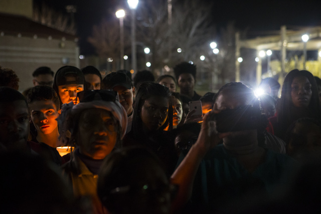 People look on during a vigil for Shadow Ridge High School student Tiris Coleman Jr, who was killed in a shooting this past Sunday, at Aviary Park in North Las Vegas on Tuesday, Feb. 21, 2017. (Ch ...