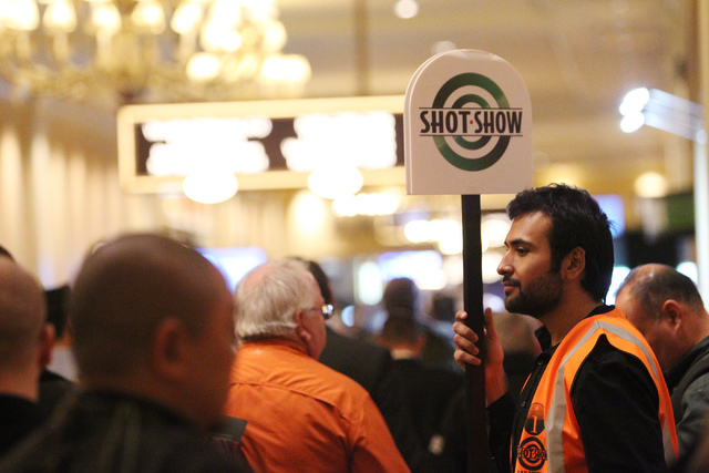 Christopher Sepulveda greets people at the Sands Expo Convention Center during the annual Shooting, Hunting and Outdoors Trade Show Tuesday, Jan. 20, 2015. (Erik Verduzco/Las Vegas Review-Journal)