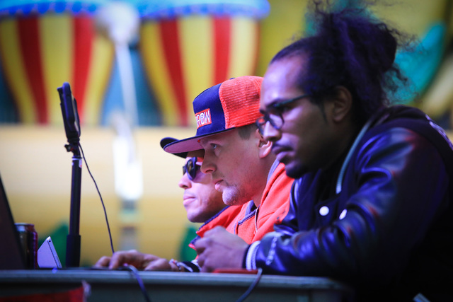 Judges watch contestants as they compete in the 10th annual World Sign Spinning Championships on the Fremont Street Experience in Las Vegas on Saturday, Feb. 25, 2017. Brett Le Blanc/Las Vegas Rev ...