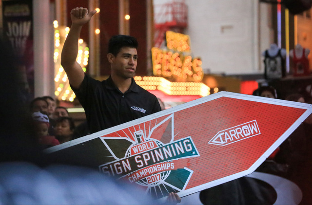 Erick Macias, of Orange County, Calif., competes in the 10th annual World Sign Spinning Championships on the Fremont Street Experience in Las Vegas on Saturday, Feb. 25, 2017. Brett Le Blanc/Las V ...