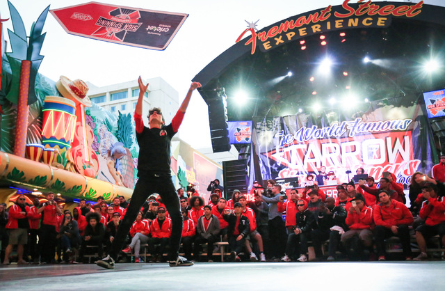 Tyler Cartwright, of Philadelphia, competes in the 10th annual World Sign Spinning Championships on the Fremont Street Experience in Las Vegas on Saturday, Feb. 25, 2017. Brett Le Blanc/Las Vegas  ...