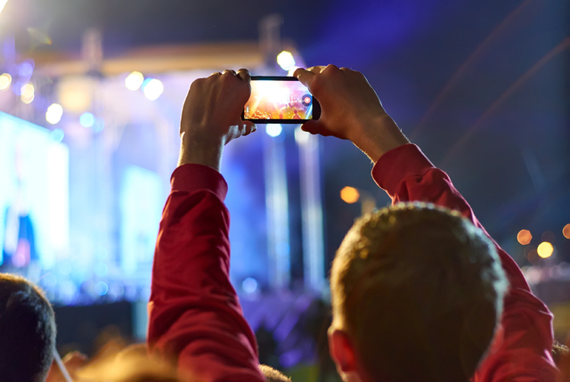 Recording video with smartphone during a concert. (Thinkstock)