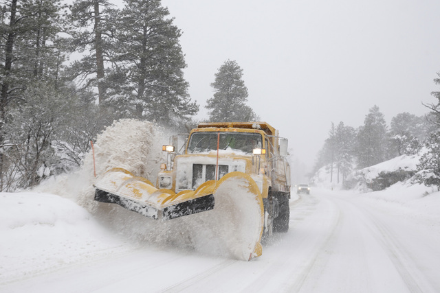 A snow plow clears Kyle Canyon road on Sunday, Jan.22, 2017, in Mount Charleston. The Nevada Highway Patrol reported more than two dozen crashes in and around Reno on Wednesday, Feb. 22, 2017, aft ...