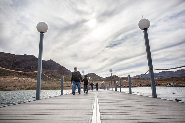 Marcaal and Alex Surtado walk on the docks at Lake Mead Marina on Tuesday, Feb 21, 2017, at Lake Mead  Recreational Area, in Boulder City. (Benjamin Hager/Las Vegas Review-Journal) @benjaminhphoto