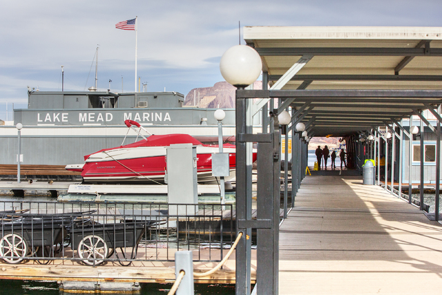 Ernesto Ezquerra, left, and Cristina Narvarte walk on the docks at Lake Mead Marina on Tuesday, Feb 21, 2017, at Lake Mead  Recreational Area, in Boulder City. (Benjamin Hager/Las Vegas Review-Jou ...