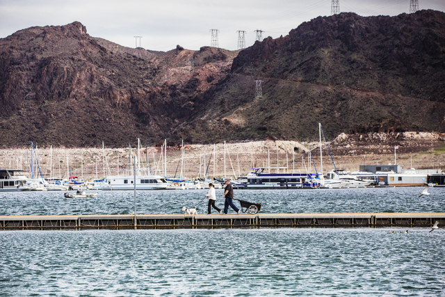 Visitors to Lake Mead Marina walk on the docks to their boat on Tuesday, Feb 21, 2017, at Lake Mead Recreational Area, in Boulder City. (Benjamin Hager/Las Vegas Review-Journal) @benjaminhphoto