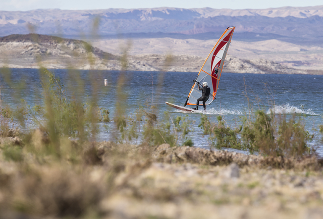 A wind surfer glides across the water at Lake Mead Marina on Tuesday, Feb 21, 2017, at Lake Mead Recreational Area, in Boulder City. (Benjamin Hager/Las Vegas Review-Journal) @benjaminhphoto