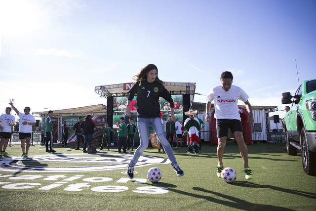 Alexis Cano, 18, left, works on soccer drills with Noe Cornejo before the men's soccer game between the national teams of Mexico and Iceland at Sam Boyd Stadium on Wednesday, Feb. 8, 2017, in Las  ...