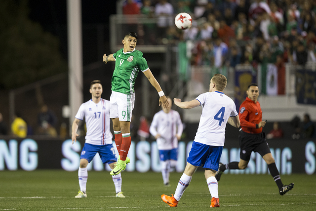 Mexico's Alan Pulido (9) heads the ball against Iceland in the men's soccer exhibition match at Sam Boyd Stadium on Wednesday, Feb. 8, 2017, in Las Vegas. (Erik Verduzco/Las Vegas Review-Journal)  ...