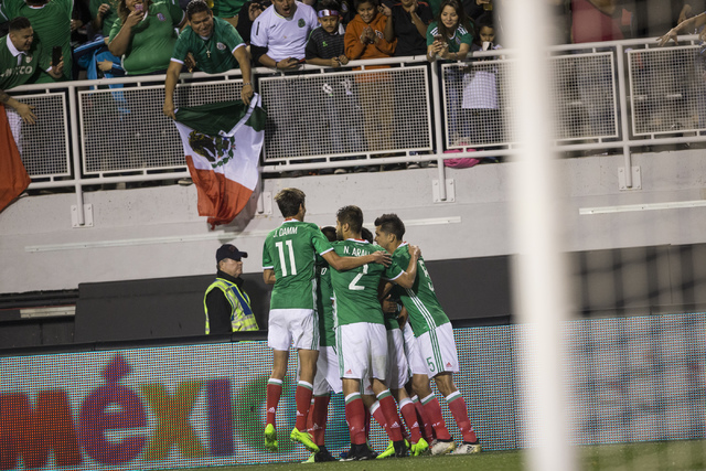 Mexico's Alan Pulido (9) celebrates with his team after scoring a goal against Iceland in the men's soccer exhibition match at Sam Boyd Stadium on Wednesday, Feb. 8, 2017, in Las Vegas. (Erik Verd ...