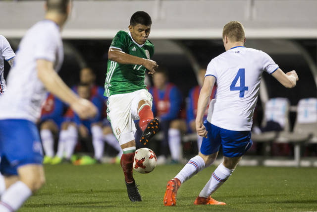 Mexico's Jesus Gallardo (17) kicks the ball for a pass against Iceland in the men's soccer exhibition match at Sam Boyd Stadium on Wednesday, Feb. 8, 2017, in Las Vegas. (Erik Verduzco/Las Vegas R ...