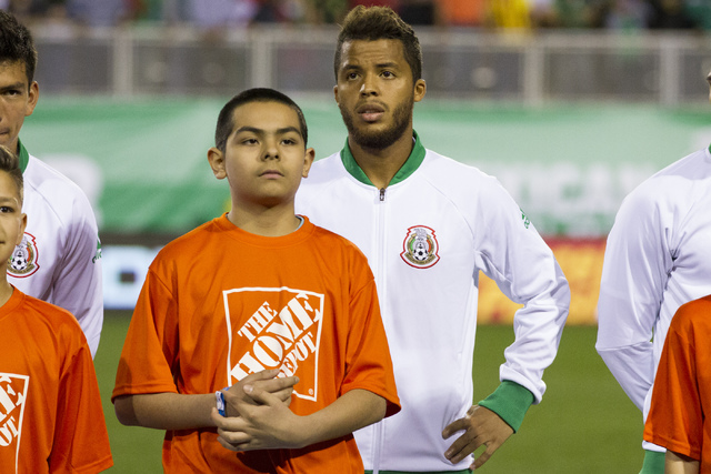 Mexico's Giovani dos Santos, center, before the men's soccer exhibition match against Iceland at Sam Boyd Stadium on Wednesday, Feb. 8, 2017, in Las Vegas. Mexico won 1-0. (Erik Verduzco/La ...