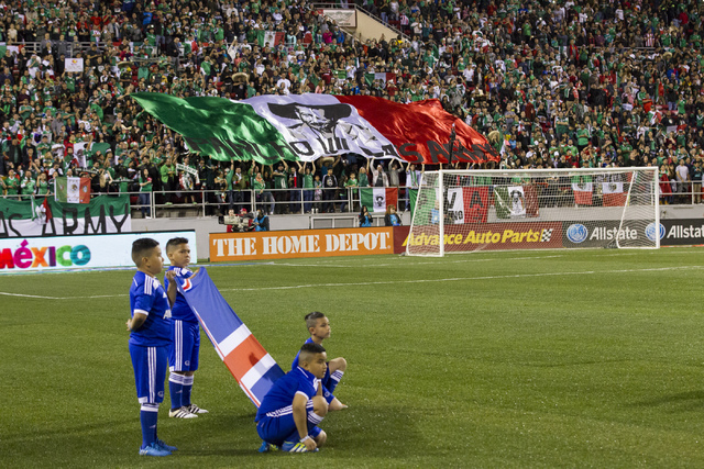 Fans display a customized flag with the Mexican colors during the men's soccer exhibition match between Mexico and Iceland at Sam Boyd Stadium on Wednesday, Feb. 8, 2017, in Las Vegas. Mexico won  ...