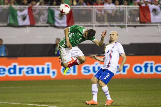 Mexico's Hirving Lozano (8) heads the ball for a missed shot at the goal against Iceland in the men's soccer exhibition match at Sam Boyd Stadium on Wednesday, Feb. 8, 2017, in Las Vegas. ( ...