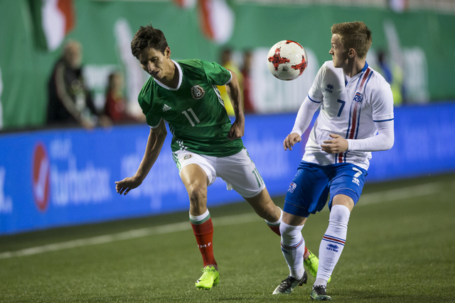 Mexicoճ Jurgen Damm (11) and Icelandsճ Aron Sigurdarson (7) fight for procession of the ball in the men's soccer exhibition match at Sam Boyd Stadium on Wednesday, Feb. 8, 2017, in Las ...