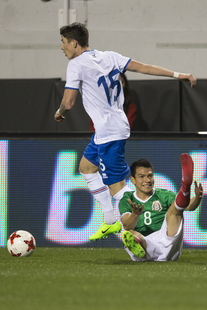Mexicoճ Hirving Lozano (8) loses a shoe during a play against Iceland in the men's soccer exhibition match at Sam Boyd Stadium on Wednesday, Feb. 8, 2017, in Las Vegas. Mexico won 1-0. (Erik ...